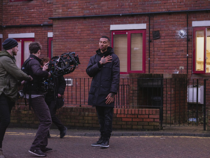 Fredo, a rapper from North-West London, photographed throughout the day whilst filming a music video near his old home on the Mozart Estate. 25 January, 2019. Shot for the FT by Harry Mitchell