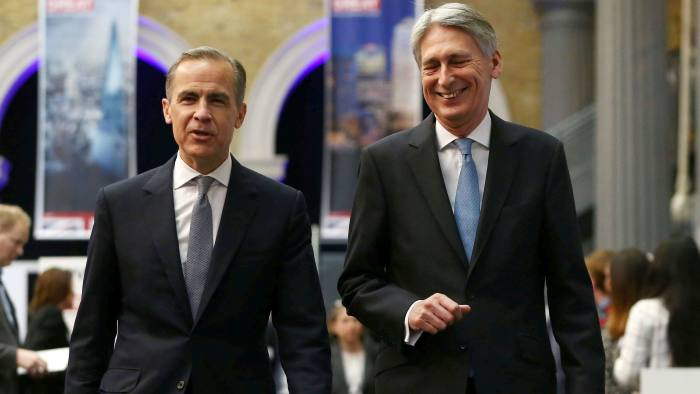 Bank of England governor Mark Carney (left) wrote to chancellor Philip Hammond pledging to work for 'a successful Brexit'