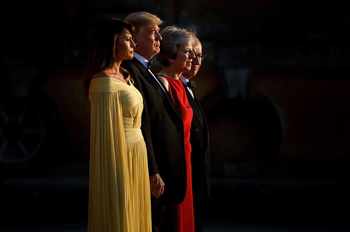 TOPSHOT - (L-R) US First Lady Melania Trump, US President Donald Trump, Britain's Prime Minister Theresa May, and her husband Philip May stand on the steps in the Great Court to watch the bands of the Scots, Irish and Welsh Guards perform a ceremonial welcome as they arrive for a black-tie dinner with business leaders at Blenheim Palace, west of London, on July 12, 2018, on the first day of President Trump's visit to the UK. The four-day trip, which will include talks with Prime Minister Theresa May, tea with Queen Elizabeth II and a private weekend in Scotland, is set to be greeted by a leftist-organised mass protest in London on Friday. / AFP PHOTO / Brendan SmialowskiBRENDAN SMIALOWSKI/AFP/Getty Images
