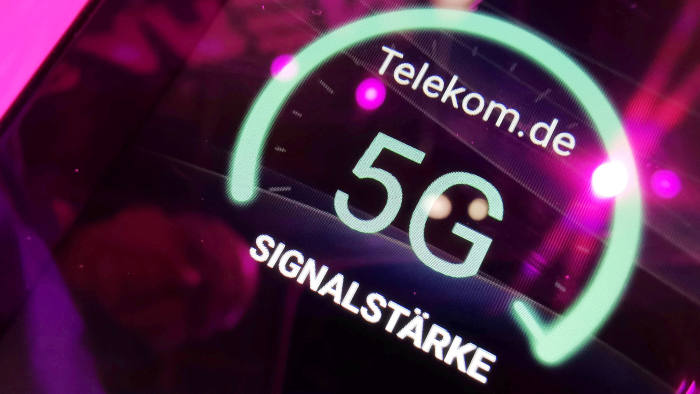 FILE PHOTO: Signal strength of Deutsche Telekom 5G is displayed on a mobile device at the IFA consumer tech fair in Berlin, Germany, September 5, 2019. REUTERS/Hannibal Hanschke/File Photo