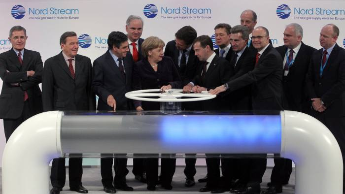 LUBMIN, GERMANY - NOVEMBER 08: (From L to R, first row) French Prime Minister Francois Fillon, German Chancellor Angela Merkel, Dutch Prime Minister Mark Rutte, Russian President Dmitry Medvedev and European Union Energy Commissioner Guenther Oettinger turn a wheel to symbolically start the flow of gas through the Nord Stream Baltic Sea gas pipeline while former German Chancellor Gerhard Schroeder (2nd L) watches at a cemerony on November 8, 2011 in Lubmin, Germany. The Nord Stream pipeline runs through the Baltic Sea and will supply Europe with natural gas from Russia. (Photo by Sasha Mordovets/Getty Images)