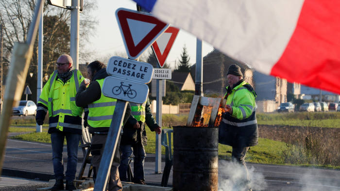 A gilet jaune protest at a roundabout  in France