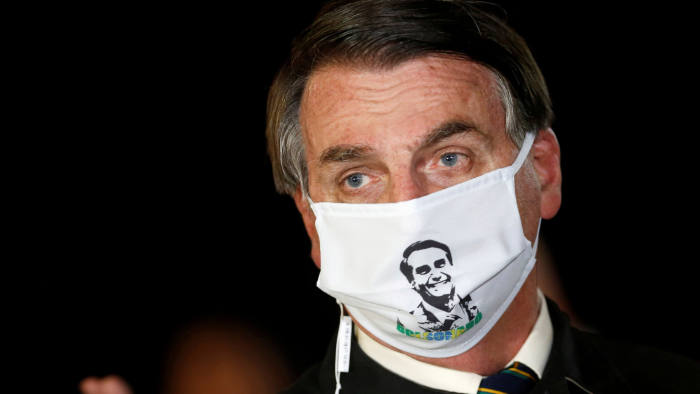 Brazil's President Jair Bolsonaro speaks with journalists while wearing a protective face mask as he arrives at Alvorada Palace, amid the coronavirus disease (COVID-19) outbreak, in Brasilia, Brazil, May 22, 2020. REUTERS/Adriano Machado TPX IMAGES OF THE DAY