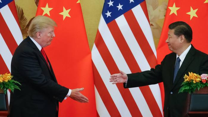US President Donald Trump, left, and Chinese President Xi Jinping in Beijing last year