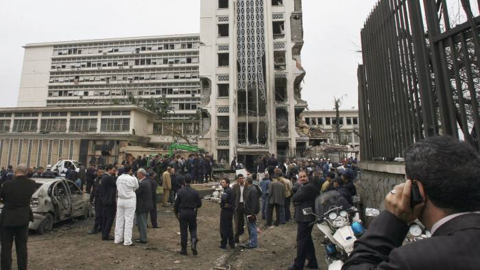 Algiers, ALGERIA: A general view shows Algerian rescuers inspecting damages of the buildings of Prime minister's offices following a suicide car exploded near the Governmental Palace in the center of Algiers City 11 April 2007. At least 23 people were killed and scores injured in a series of car bombs that rocked the Algerian capital, including one that targeted the government headquarters. AFP PHOTO/FAYEZ NURELDINE (Photo credit should read FAYEZ NURELDINE/AFP/Getty Images)
