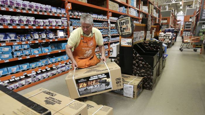 FILE - In this Wednesday, May 18, 2016, file photo, Home Depot supervisor David Petersen stacks barbecue smokers at a Home Depot store location, in Bellingham, Mass. The Home Depot Inc. reports earnings Tuesday, May 16, 2017.  (AP Photo/Steven Senne, File)
