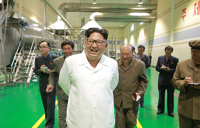 """In this undated photo provided on July 10, 2018, by the North Korean government, North Korean leader Kim Jong Un, center, visits a potato farina production factory in Samjiyon County, North Korea. Independent journalists were not given access to cover the event depicted in this image distributed by the North Korean government. The content of this image is as provided and cannot be independently verified. Korean language watermark on image as provided by source reads: """"KCNA"""" which is the abbreviation for Korean Central News Agency. (Korean Central News Agency/Korea News Service via AP)"""