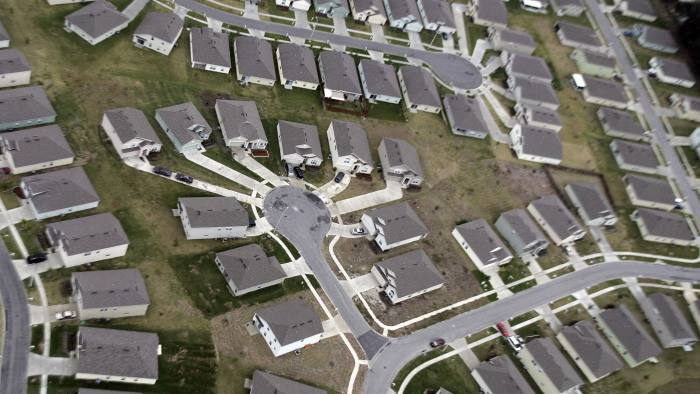 """TO GO WITH STORY by Rob Lever, US-econom...Orlando, UNITED STATES: TO GO WITH STORY by Rob Lever, US-economy-property (FILES) In this 02 February 2007 file photo, a new housing subdivision outside of Orlando, Florida, is seen in an aerial photograph. Fresh troubles in the subprime segment of the US housing market have ignited fears of contagion that could affect the financial sector and possibly the broader economy, analysts say. Those fears were fanned this week as rating agencies Standard & Poor's and Moody's both warned of potential credit downgrades for bonds backed by subprime mortgages, which could affect investors and banks that issued the obligations. """"New data reveals that delinquencies and foreclosures continue to accumulate at an increasing rate,"""" S&P said. The news triggered a slide in the US dollar and Wall Street shares on 10 June 2007 as investors reassessed their exposure to risky assets like mortgage-backed securities. AFP PHOTO/JEFF HAYNES/FILES (Photo credit should read JEFF HAYNES/AFP/Getty Images)"""