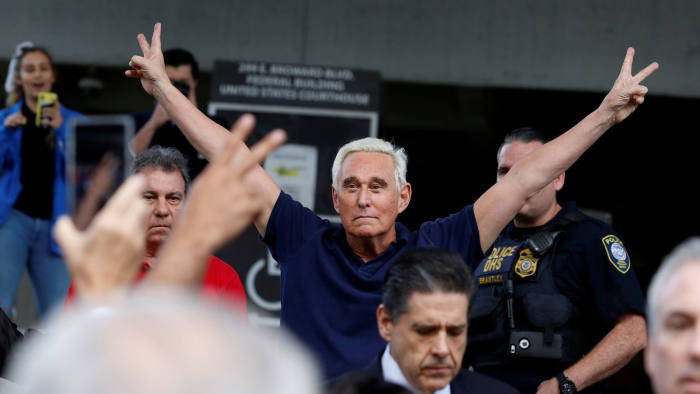 Roger Stone reacts as he walks to microphones after his appearance at Federal Court in Fort Lauderdale, Florida, U.S., January 25, 2019. REUTERS/Joe Skipper     TPX IMAGES OF THE DAY