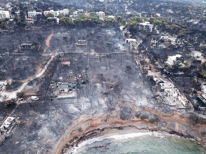 Aerial view of the area after a wildfire, in Mati, Greece July 24, 2018 in this picture obtained from social media July 26, 2018. FLYGREECEDRONE/via REUTERS THIS IMAGE HAS BEEN SUPPLIED BY A THIRD PARTY. MANDATORY CREDIT. NO RESALES. NO ARCHIVES.