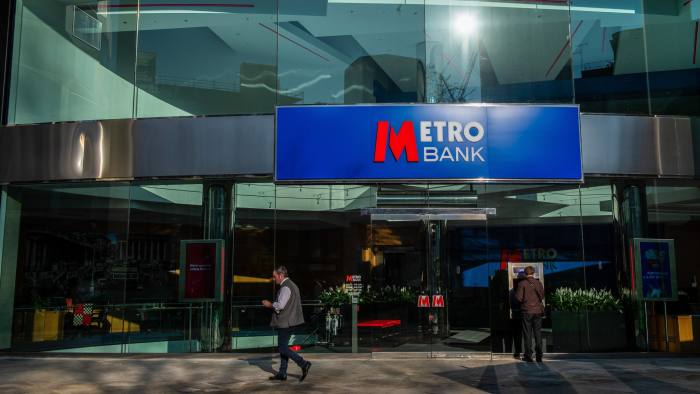 A pedestrian passes a branch of Metro Bank Plc in the City of London, U.K., on Wednesday, Feb. 27, 2019. Metro Bank, the lender founded by U.S. entrepreneur Vernon Hill, plunged to a record low after it disclosed that British regulators are probing how it misclassified assets, an incident that prompted a share sale. Photographer: Chris J. Ratcliffe/Bloomberg