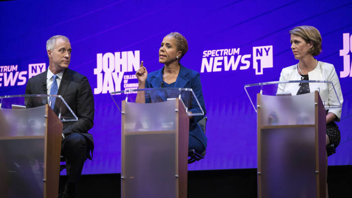 Candidates Sean Patrick Maloney, left and Zephyr Teachout, right, listen as Leecia Eve speaks during the Democratic Primary debate for New York State Attorney General at John Jay College of Criminal Justice in New York, Tuesday, Aug. 28, 2018. All of the candidates stressed the AG's role in rooting out corruption and reforming the criminal justice system. (Holly Pickett/New York Times via AP, Pool)