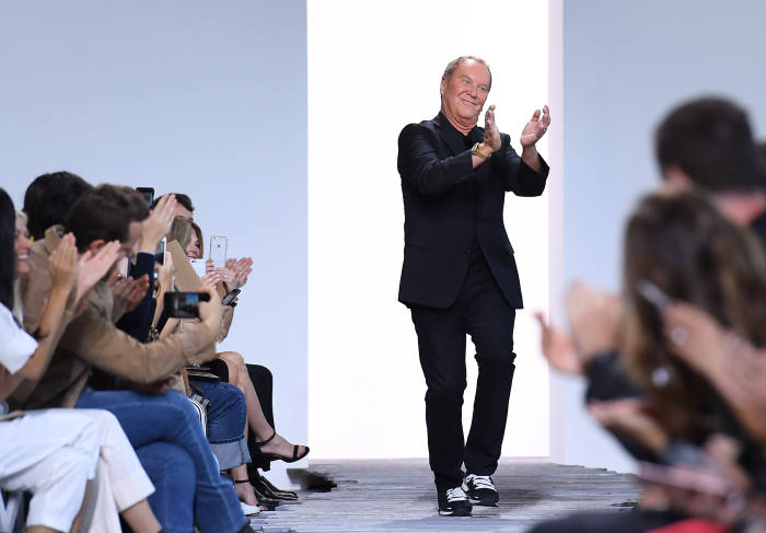 Designer Michael Kors acknowledges the audience at his Michael Kors Collection Spring 2018 Runway Show at Spring Studios on September 13, 2017, during New York Fashion Week in New York. ANGELA WEISS/AFP/Getty Images