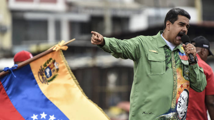 """Nicolas Maduro, Venezuela's president, speaks during a campaign rally in Caracas, Venezuela, on Thursday, May 17, 2018. Maduro said the May 20 presidential election will offer the world """"a lesson in democracy."""" Photographer: Carlos Becerra/Bloomberg"""
