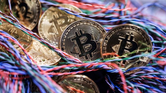Bitcoins in an office in London, U.K. Photographer: Chris Ratcliffe/Bloomberg