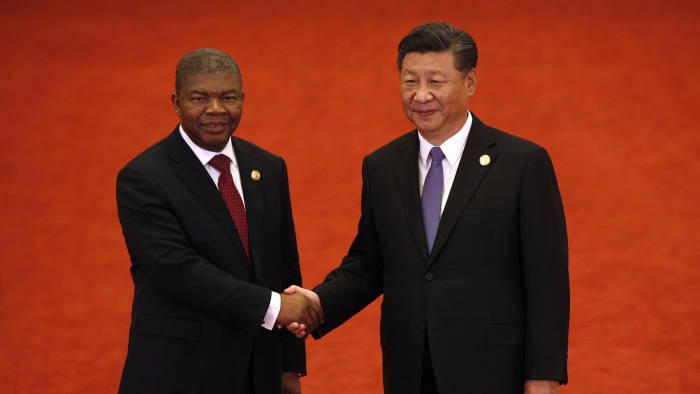 BEIJING, CHINA - SEPTEMBER 03: Angola's President Joao Lourenco, left, shakes hands with Chinese President Xi Jinping during the Forum on China-Africa Cooperation held at the Great Hall of the People on September 3, 2018 in Beijing, China. (Photo by Andy Wong - Pool/Getty Images)
