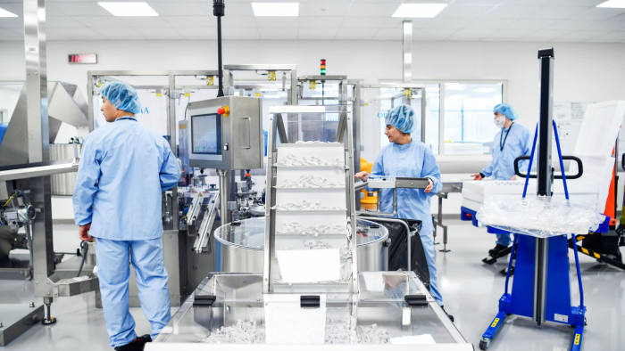 Operators work on the pre-filled syringes assembly line at AstraZeneca Plc's new Biologics factory in Sodertalje, Sweden, on Thursday, April 11, 2019. AstraZeneca raised its annual sales forecast, helped by demand for the U.K. drugmaker's roster of new cancer drugs. Photographer: Mikael Sjoberg/Bloomberg via Getty Images