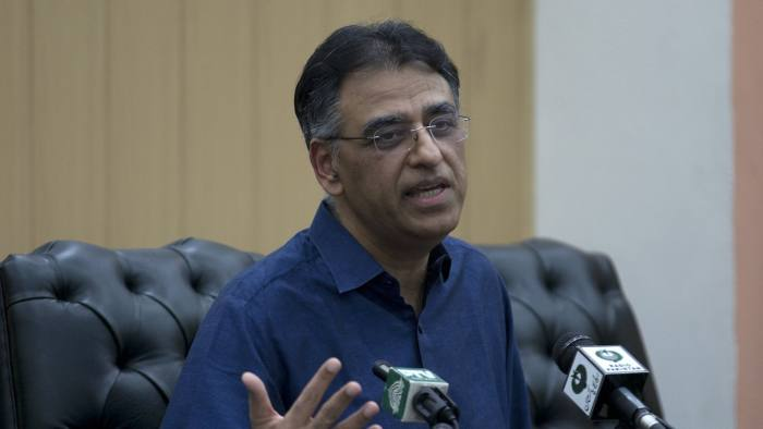 """Pakistan's Finance Minister Asad Umar addresses a news conference in Islamabad, Pakistan, Thursday, April 18, 2019. Umar says he will step down amid a wave of criticism over the government's handling of a financial crisis that has sent prices soaring. Umar tweeted Thursday, that Prime Minister Imran Khan offered him the energy portfolio in the Cabinet but he refused. He defended Khan's leadership, calling him the """"best hope"""" for Pakistan.(AP Photo/B.K. Bangash)"""