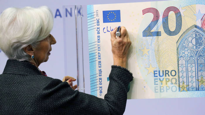 Mandatory Credit: Photo by ARMANDO BABANI/EPA-EFE/Shutterstock (10486301c) European Central Bank (ECB) President Christine Lagarde signs the new 20 Euro banknote in Frankfurt am Main, Germany, 27 November 2019. The signing of new euro banknotes is a traditional act that takes place at the beginning of each ECB presidency. European Central Bank (ECB), Frankfurt, Germany - 27 Nov 2019