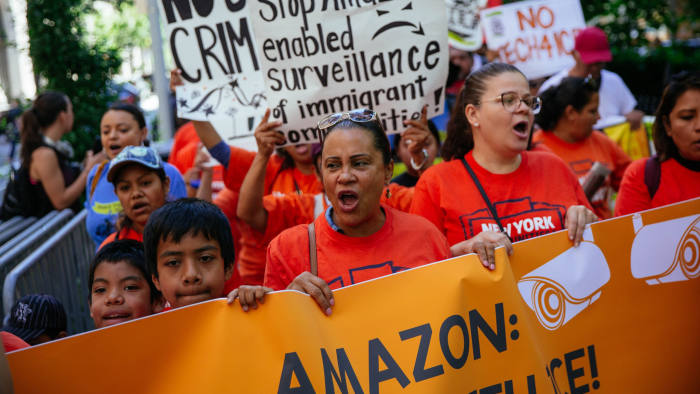 NEW YORK, NY - JULY 15: Protestors march to a building where Amazon owner Jeff Bezos owns property on July 15, 2019 in New York City. The protest, raising awareness of Amazon facilitating ICE surveillance efforts, coincides with Amazon's Prime Day, when Amazon offers discounts to Prime members. (Photo by Kevin Hagen/Getty Images)