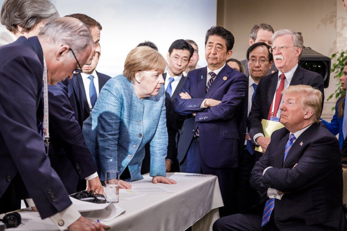 """TOPSHOT - Photo released on Twitter by the German Governments spokesman Steffen Seibert on June 9, 2018 and taken by the German government's photographer Jesco Denzel shows US President Donald Trump (R) talking with German Chancellor Angela Merkel (C) and surrounded by other G7 leaders during a meeting of the G7 Summit in La Malbaie, Quebec, Canada. The photo went viral, popping up all over social media, sometimes in its original form sometimes altered for humorous or satirical ends. / AFP PHOTO / Bundesregierung / Jesco DENZEL / RESTRICTED TO EDITORIAL USE - MANDATORY CREDIT """"AFP PHOTO / BUNDESREGIERUNG / JESCO DENZEL - NO MARKETING NO ADVERTISING CAMPAIGNS - DISTRIBUTED AS A SERVICE TO CLIENTS JESCO DENZEL/AFP/Getty Images"""