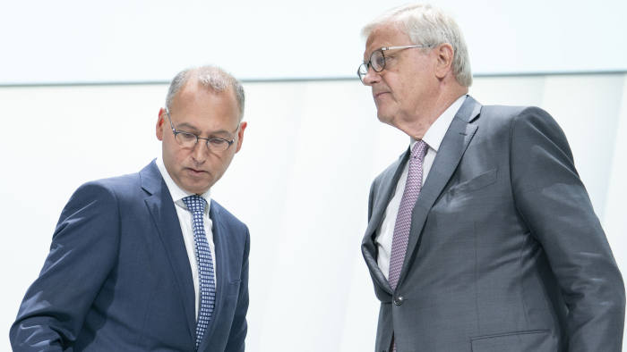 Werner Baumann, chief executive officer of Bayer AG, left, stands with Werner Wenning, chairman of Bayer AG, prior to the company's annual general meeting in Bonn, Germany, on Friday, April 26, 2019. Baumann faces the biggest test of his three-year tenure as shareholders increasingly upset with the Monsanto takeover gather for a day-long meeting that will culminate in a crucial confidence vote. Photographer: Jasper Juinen/Bloomberg