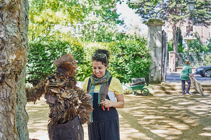 Meital Tzabari, a furniture designer and maker, working on a sculpture made from leaves at the Geffrye Museum as part of the Chelsea Fringe. 19/05/2018