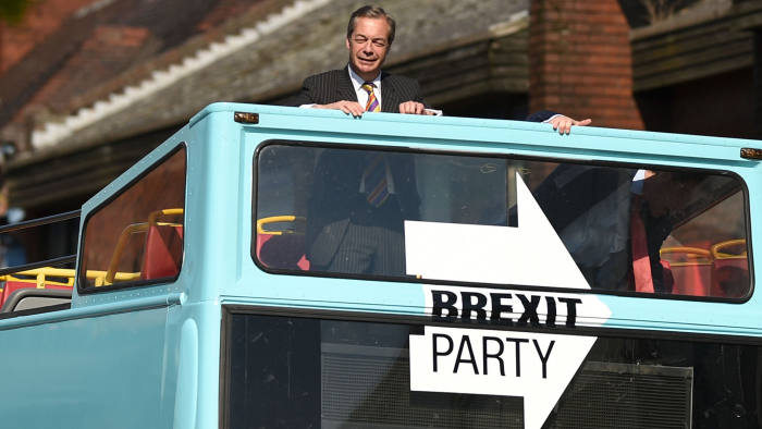 TOPSHOT - Brexit Party leader Nigel Farage (C) rides on their bus during a visit campaigning for the European Parliament election in Pontefract, northwest England, on May 13, 2019. - The newly-formed Brexit Party, which wants a clean break from the EU, has doubled its lead over other British parties in an opinion poll out Sunday on the European Parliament elections. Despite voting in a referendum to leave the European Union in 2016 Britain is braced to take part in the European Parliament election on May 23. (Photo by Oli SCARFF / AFP)OLI SCARFF/AFP/Getty Images
