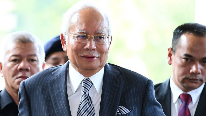 Malaysia's former prime minister Najib Razak arrives for a court appearance at the Duta court complex in Kuala Lumpur on August 10, 2018. - Razak was hit with new charges linked to a multi-billion-dollar financial scandal that contributed to his shock election defeat in May. (Photo by MOHD RASFAN / AFP) (Photo credit should read MOHD RASFAN/AFP/Getty Images)