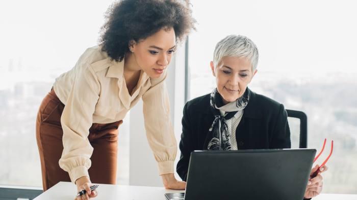 Beautiful women using laptop at office