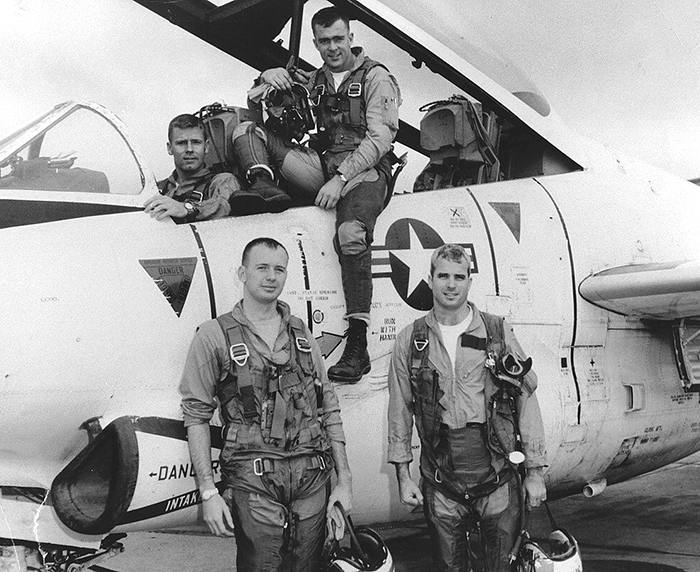 John McCain (Bottom R) poses with his U.S. Navy squadron in 1965. National Archives/Handout via REUTERS. ATTENTION - THIS IMAGE HAS BEEN SUPPLIED BY A THIRD PARTY - RC1DEE7B0B10