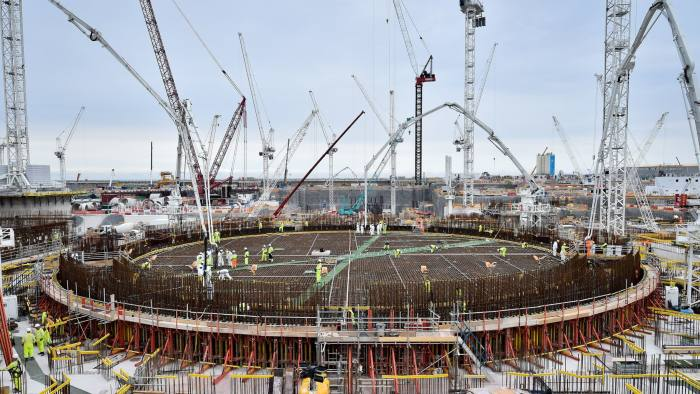 The base for the first reactor at Hinkley Point C power station near Bridgwater, Somerset, a huge circular mass of reinforced steel is filled with the UK's largest ever concrete pour, around 9'000M3, as construction progresses. PRESS ASSOCIATION Photo. Picture date: Thursday June 27, 2019. The new multi billion pound Hinkley Point C nuclear power station has reached its biggest milestone with completion of the base for the first reactor. Construction of the nuclear buildings above ground at the site in Somerset can now begin in earnest, said operators EDF Energy. The final amount of concrete was the largest ever recorded in the UK, beating a record set by the Shard in London, said EDF. See PA story INDUSTRY Hinkley. Photo credit should read: Ben Birchall/PA Wire