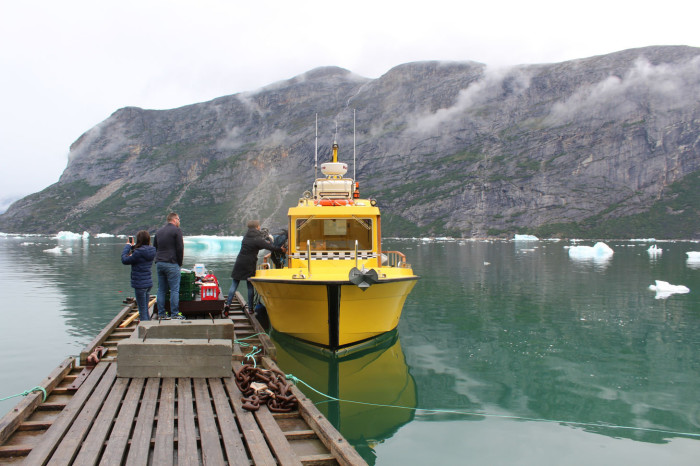 taxi boat arrives at the camp . credit Tom Robbins