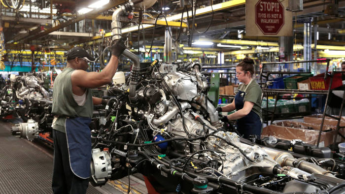General Motors assembly workers work on the chassis of Chevrolet 2019 heavy-duty pickup trucks at General Motors Flint Assembly Plant in Flint, Michigan, U.S. February 5, 2019. REUTERS/Rebecca Cook - RC1669CAA370