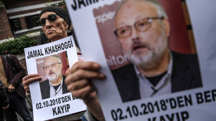"""(FILES) This file photo taken on October 9, 2018 shows protesters holding portraits of missing journalist and Riyadh critic Jamal Khashoggi with the caption: """"Jamal Khashoggi is missing since October 2"""" during a demonstration in front of the Saudi Arabian consulate in Istanbul. - Jamal Khashoggi went from being a Saudi royal family insider to an outspoken critic of the ultra-conservative kingdom's government. The Saudi journalist -- who was last seen on October 2 entering his country's consulate in Istanbul -- went into self-imposed exile in the United States in 2017 after falling out with Crown Prince Mohammed bin Salman. (Photo by OZAN KOSE / AFP)OZAN KOSE/AFP/Getty Images"""