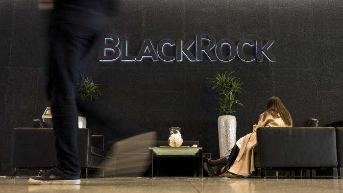 A logo sits on display in the atrium of the Blackrock Inc. offices in London, U.K., on Friday, Feb. 7, 2020. An early front-runner for a successor as the Bank of Canada governor is Jean Boivin, the head of BlackRock Inc.s research unit in London and a Carney protege who was brought to the Bank of Canada in 2010 from academia. Photographer: Simon Dawson/Bloomberg via Getty Images