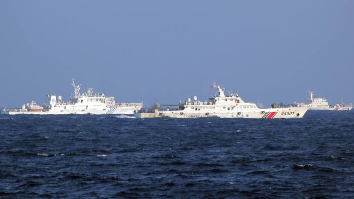 epa04209260 A picture made available 16 May 2014 shows Chinese coast guard vessels near the area of China's oil drilling rig in disputed waters in the South China Sea, off shore Vietnam, 14 May 2014. Vietnam accused Chinese boats of repeatedly ramming Vietnamese vessels near disputed waters in the South China Sea where China has placed an oil drilling platform near the Paracel Islands. EPA/STR
