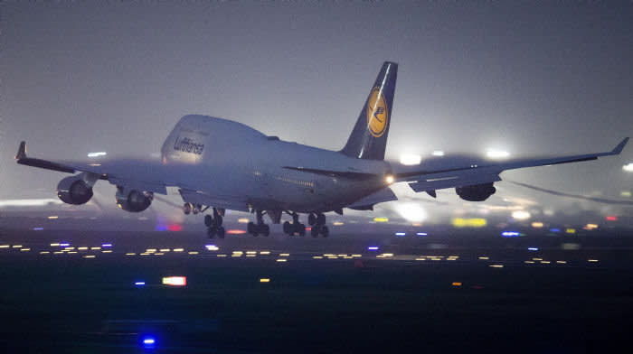 A Boeing 747 of Lufthansa lands on the international airport in Frankfurt, Germany, Saturday, Jan. 25, 2020. (AP Photo/Michael Probst)