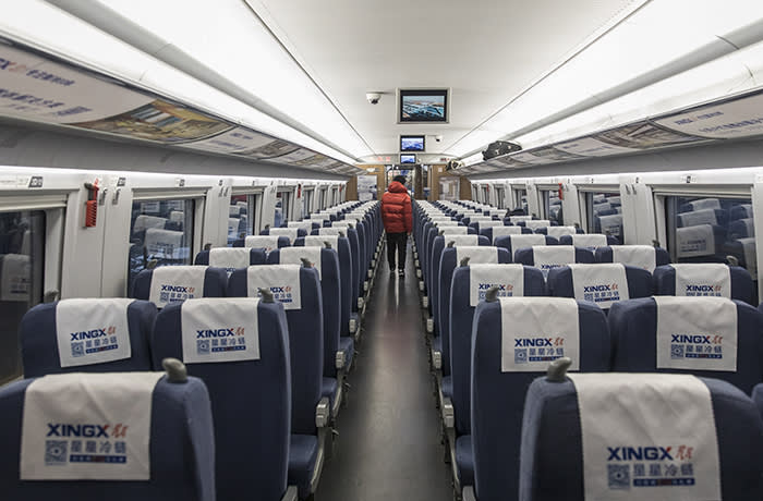 A passenger walks through an empty carriage on a high-speed train destined for Guangzhou as it leaves the station in Shanghai, China, on Tuesday, Feb. 11, 2020. The death toll from the coronavirus climbed above 1,000, as the Chinese province at the epicenter of the outbreak reported its highest number of fatalities yet. Photographer: Qilai Shen/Bloomberg
