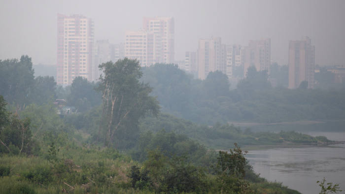 KEMEROVO, RUSSIA - JULY 25, 2019: Smoke from forest fires in the city of Kemerovo in south Siberia; currently large areas of West Siberia are hit by wild fires. Danil Aikin/TASS