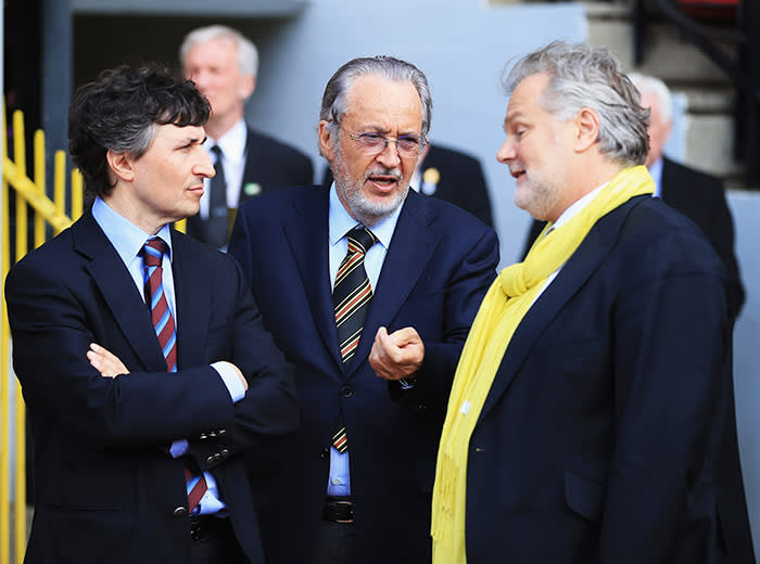 WATFORD, ENGLAND - MAY 04: Watford owner Giampaolo Pozzo (C) and son Gino (L) talk to technical director Gianluca Nani after the npower Championship match between Watford and Leeds United at Vicarage Road on May 4, 2013 in Watford, England. (Photo by Richard Heathcote/Getty Images)