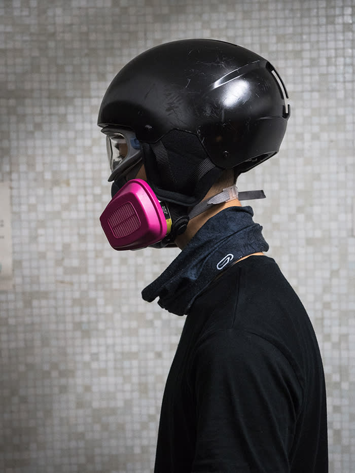 Protester Nick Wu, who now spends his weekends wearing a gas mask and a helmet: 'We've learnt the system is stacked against us so we've become less peaceful'
