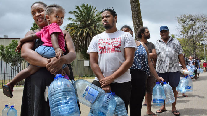 People wait in line for water in Cape Town on Feb. 16, 2018. In June, the South African city is expected to become the first major world city to completely run out of water, according to media reports. (Kyodo) ==Kyodo (Photo by Kyodo News via Getty Images)