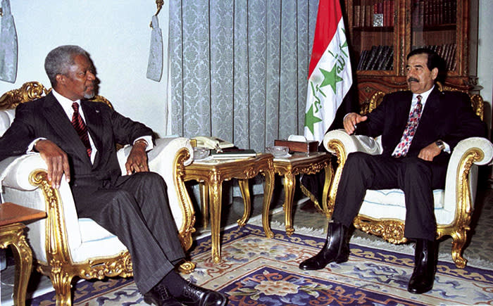 Iraqi President Saddam Hussein, right, meets UN Secretary-General Kofi Annan in Baghdad Sunday, Feb. 22, 1998. Annan is in Baghdad in a last attempt to reach and peaceful solution to the current standoff between Iraq and the UN. (AP Photo/INA, Pool)