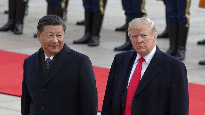 FILE- In this Nov. 9, 2017, file photo U.S. President Donald Trump, right, walks with Chinese President Xi Jinping during a welcome ceremony at the Great Hall of the people in Beijing. Trump is to meet with Xi at the Group of 20 summit in Buenos Aires, Argentina, on Friday, Nov. 30, and Saturday, Dec. 1. (AP Photo/Andy Wong, File)