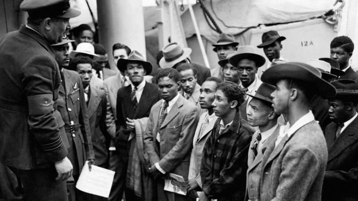 Jamaican immigrants are welcomed by RAF officials from the Colonial Office in 1948 after the Windrush landed them at Tilbury