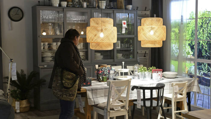 In this Thursday Nov. 22, 2018 photo, a customer looks at furniture in a new Ikea store, in Warsaw, Poland. The store, recently opened in a city shopping mall, is part of a global strategy by the Swedish furniture chain to adapt to a changing consumer environment by opening small, accessible stores in city centers to complement the traditional large out-of-town store stores. (AP Photo/Alik Keplicz)