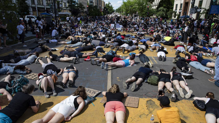 WASHINGTON, DC - JUNE 07: Thousands of protestors lie in the middle of the recently renamed Black Lives Matter Plaza near the White House during demonstrations over the death of George Floyd while in police custody on June 7, 2020 in Washington, D.C. This is the 13th day of protests since Floyd died in Minneapolis police custody on May 25. (Photo by Samuel Corum/Getty Images)
