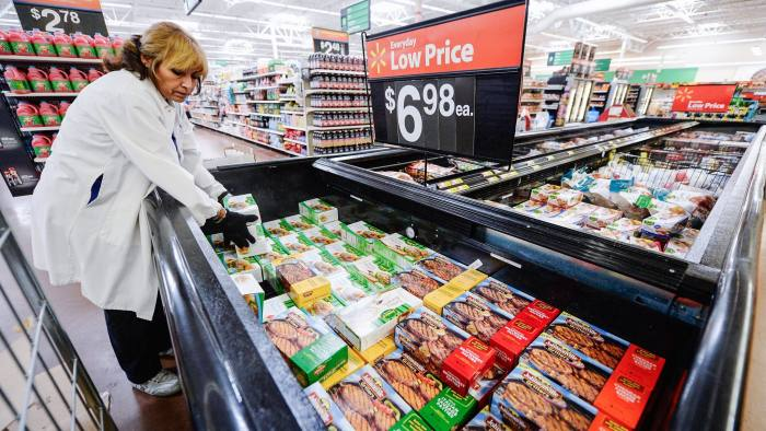 PICO RIVERA, CA - MAY 30: Employee Lucy Rodriguez stocks the frozen meat section of a Walmart Supercenter store on May 30, 2013 in Pico Rivera, California. Walmart is the largest private employer in the United State employing 13,000 employees in Los Angeles County and 75,000 in the state of California. (Photo by Kevork Djansezian/Getty Images)