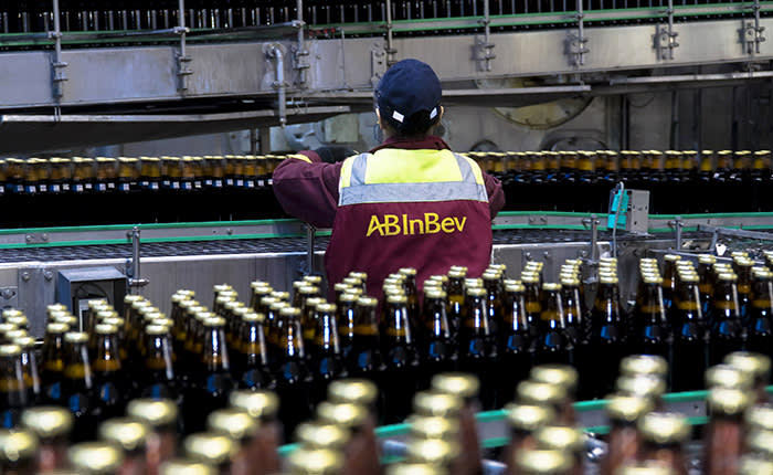 A worker checks bottles of Taller lager as they move along a conveyor belt on the production line at the OAO SUN Inbev beer plant, a unit of Anheuser-Busch InBev NV, in Chernihiv, Ukraine, on Friday, March 3, 2017. SUN InBev brews both national and international beer brands including Bud, Stella Artois and Corona. Photographer: Vincent Mundy/Bloomberg